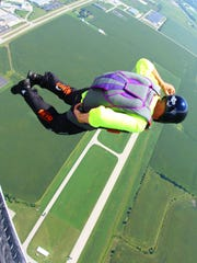 Veteran skydiver Jay Stokes, shown jumping out of a single-engine turbine airplane on Sept. 5, 2014, at the Frankfort (Ind.) Municipal Airport in Frankfort, set the world record in 2006 for number of jumps in a 24-hour period with 640 jumps.