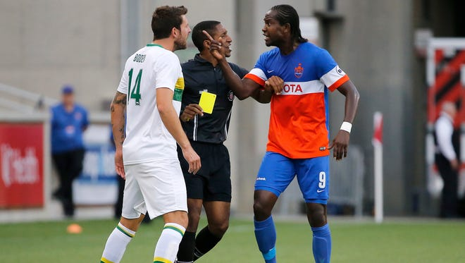 FC Cincinnati forward Djiby Fall (9) argues with Tampa Bay Rowdies defender Luke Boden (14) in the first half.