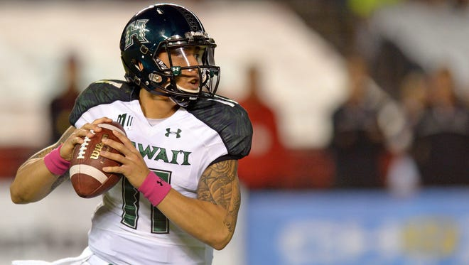 Hawaii quarterback Ikaika Woolsey looks to pass against San Diego State on Oct. 18.