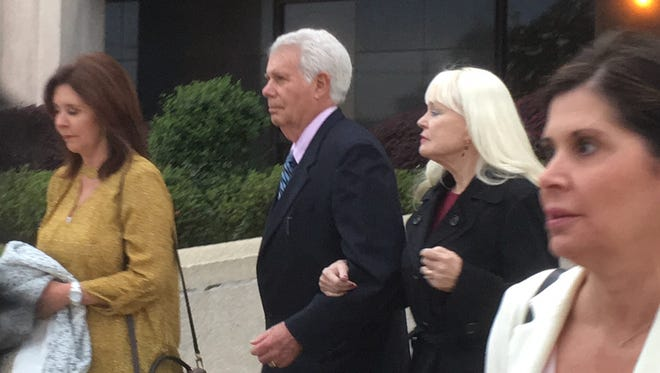 Coast Dr. Albert Diaz leaves William M. Colmer Federal Courthouse on Thursday with his family.
