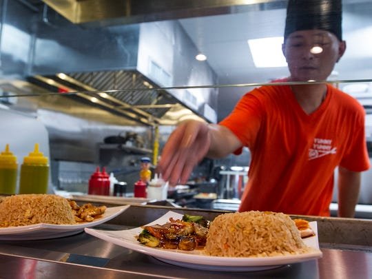 Won Cho, a hibachi chef at Yummy Yummy restaurant in Cape Coral, prepares a a few lunch entrees for customers in September 2016.