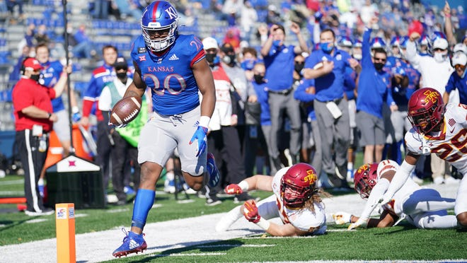 Kansas running back Daniel Hishaw scores a touchdown during last Saturday's 52-22 defeat to then-No. 23 Iowa State at David Booth Kansas Memorial Stadium in Lawrence. A true freshman, Hishaw was one of three underclassmen to score a touchdown for the Jayhawks against the Cyclones.
