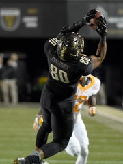 Vanderbilt tight end Jared Pinkney (80) hauls in a pass against Tennessee in the 2016 season.