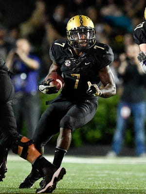 Vanderbilt running back Ralph Webb (7) runs the ball against Kansas State during the first half Saturday, Sept. 16, 2017.