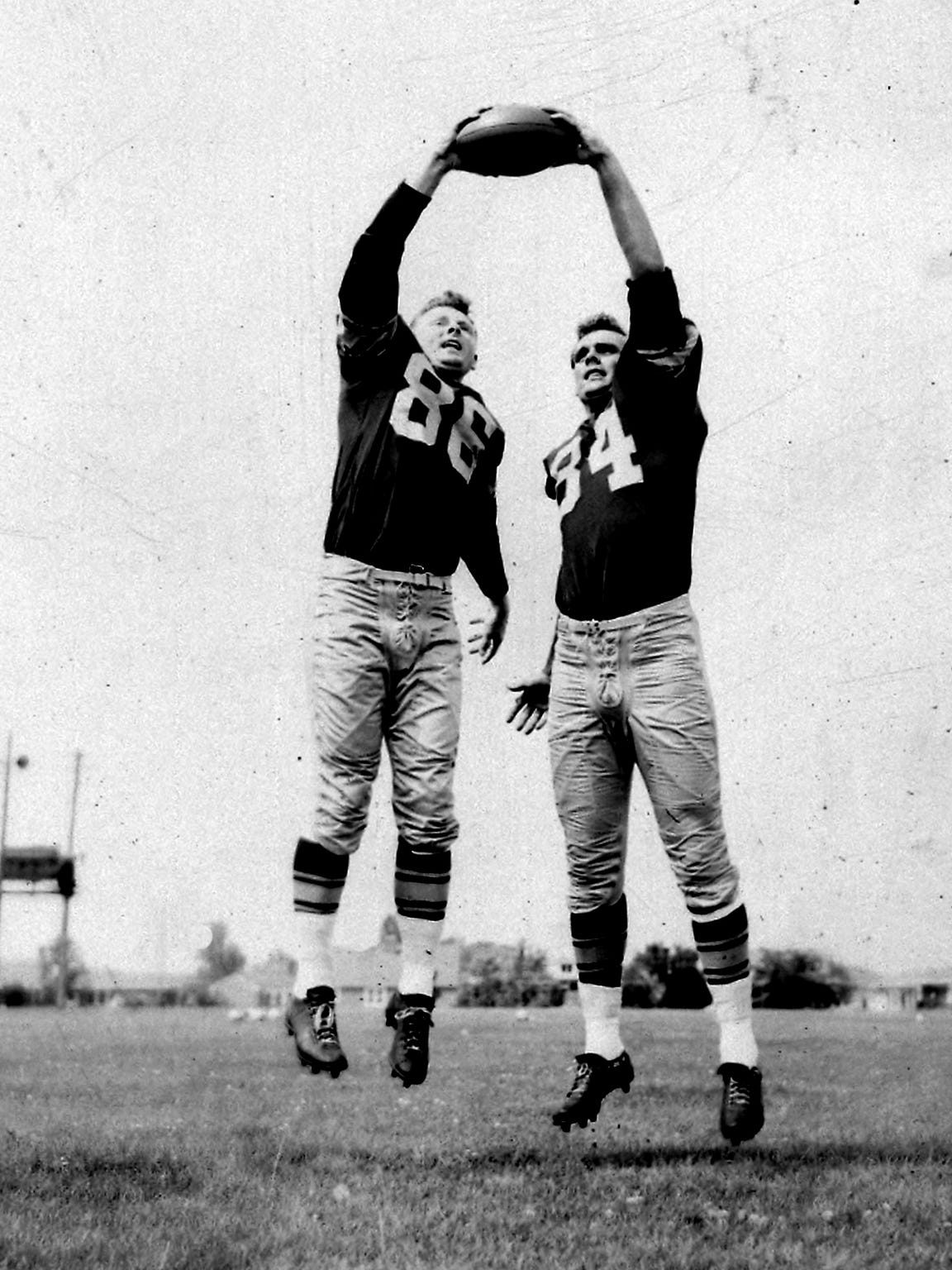 Green Bay Packers ends Billy Howton, left, and Gary Knafelc, who posed for this photo in early August 1957, scored key touchdowns in the team's first game at new City Stadium about six weeks later.