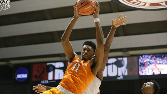 Vols forward Kyle Alexander (11) comes down with a rebound against Alabama on Saturday.