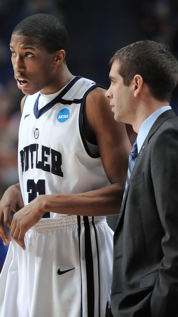 FILE -- Butler's Kameron Woods talks with head coach Brad Stevens during the 2013 NCAA tournament.