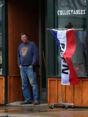 Randy Huff, 59, of Antigo, surveys the block outside of his store, Antigo Resale Frontier, in downtown Antigo, Wisconsin, during the rainy morning hours April 25, 2016.