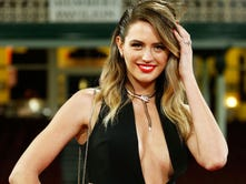 Jesinta Campbell accompanied the AFL's Lance Franklin to the Brownlow Medal ceremony. Do you think AFL stands for Australian Football League or Arena Football League or American Federation of Labor? You're right -- who cares?