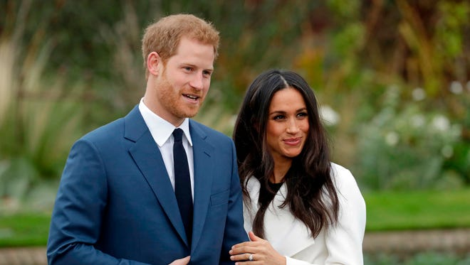 Britain's Prince Harry and his fiancee Meghan Markle on the day of their engagement announcement in November. Here they are on the grounds of Kensington Palace in London.