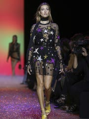 A model wears a creation for Elie Saab's Spring-Summer 2017 Ready to Wear fashion collection presented Saturday.