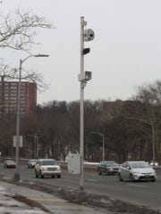 A pole-mounted red-light camera on Central Park Avenue near Arlington Street in Yonkers.