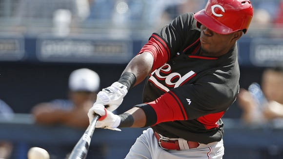 Roger Bernadina knocks a double off San Diego Padres pitcher Burch Smith to score Zack Cozart during the third inning of their exhibition game played at Peoria Sports Complex in Peoria, Arizona