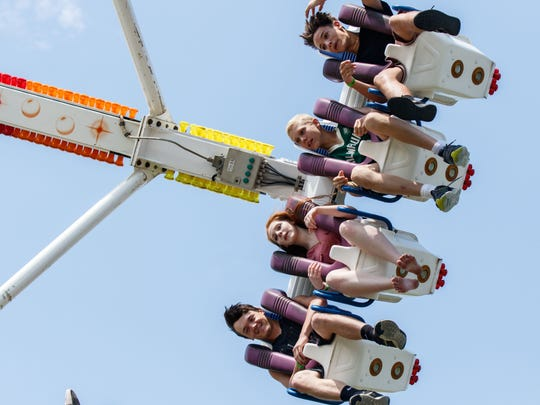 Fairgoers are seen upside down on the Freak Out carnival ride during Lions Daze in Sussex.