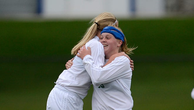 Green Bay Notre Dame's Grace Shaw (6) gets a hug from teammate Miranda Hansen (10) after Shaw scored a goal against De Pere during a May 13 game at Notre Dame Academy.
