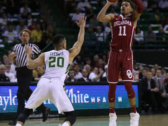 Oklahoma guard Trae Young, right, pulls up while shooting over Baylor guard Manu Lecomte during the first half of an NCAA college basketball game Tuesday, Feb. 27, 2018, in Waco, Texas. (Rod Aydelotte/Waco Tribune Herald, via AP)
