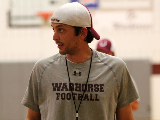 The new head coach of the Owen High School boys basketball team is familiar -Clint McElrath graduated from the school in 2002 and returned to teach there two years ago.