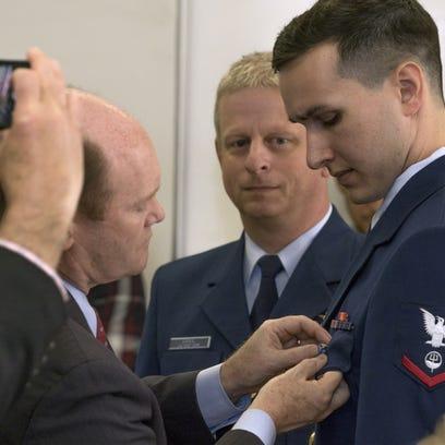 Senator Chris Coons pins the Silver Lifesaving Medal