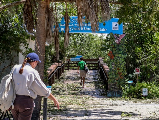 Workers return to the refuge Tuesday morning. J.N.