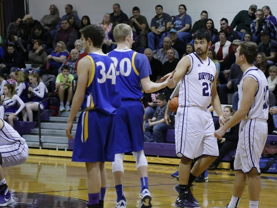 Ali Abel-Ferretti, second from right, before a conference matchup against Trumansburg on Jan. 23