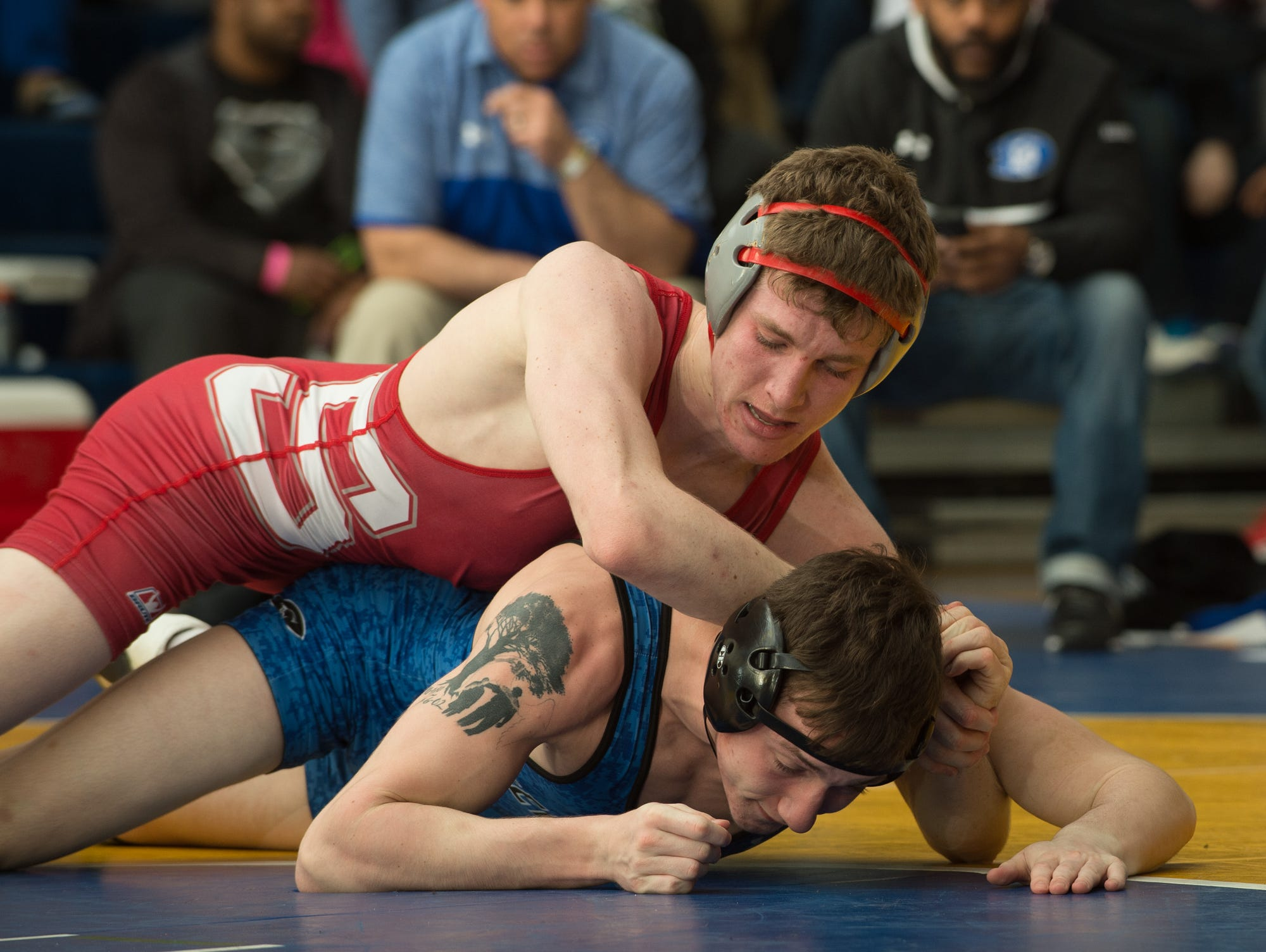 Smyrna's Chase Archangelo holds Dover's Nicholas Lee down on the mat in the 145 pound championship match at the Henlopen Conference wrestling tournament at Sussex Central High School.