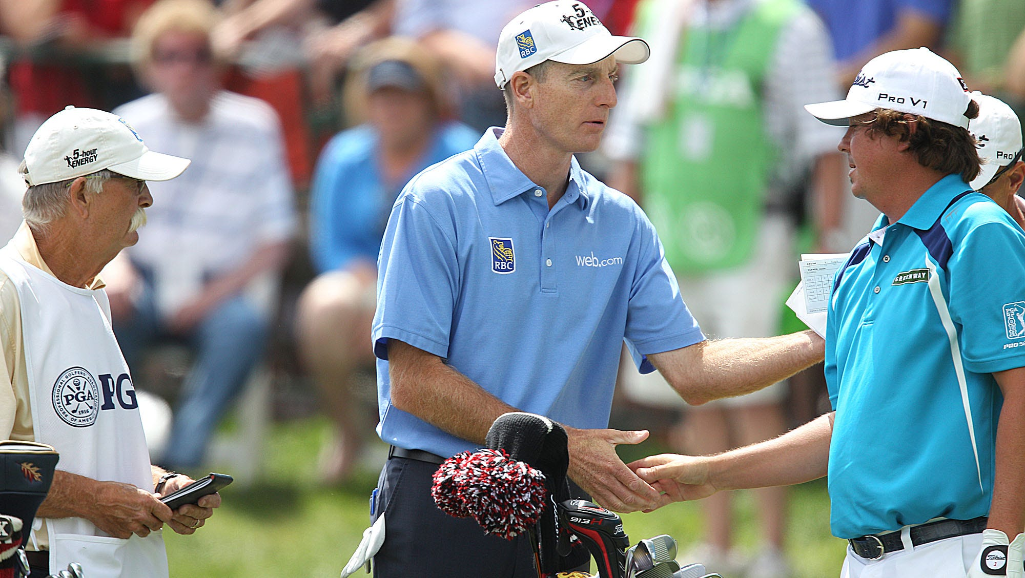 Jim Furyk and Jason Dufner shake hands before teeing off on the first hole at Oak Hill Sunday.