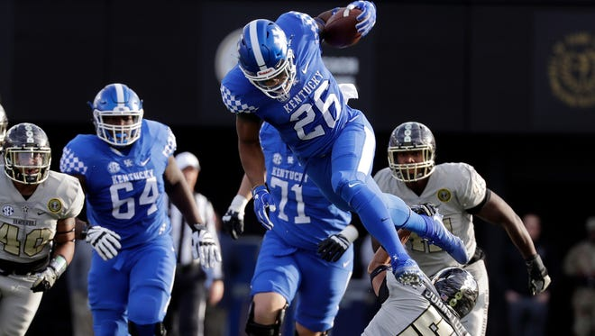 Kentucky running back Benny Snell Jr. (26) leaps over Vanderbilt safety LaDarius Wiley (5) in the first half of an NCAA college football game Saturday, Nov. 11, 2017, in Nashville, Tenn.