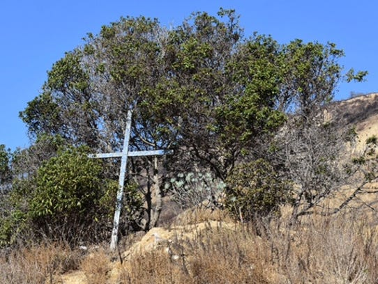 A cross in La Conchita remains after a landslide that