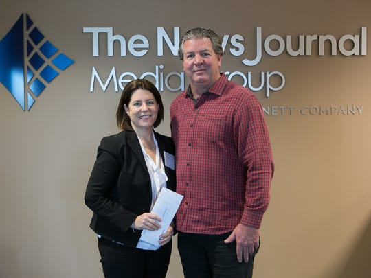Tara Quinn with Vision to Learn receives a Gannett Foundation Grant from Thomas Donovan, President/Publisher and Northeast Regional President of Gannett East Group.