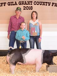 Arya Laney exhibits her light cross swine which placed