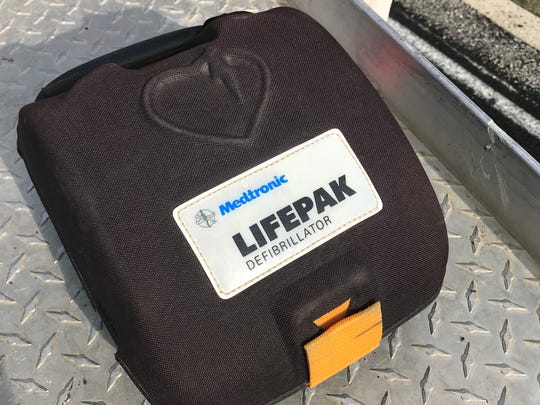 This portable defibrillator saved Vinny Romano's life when he had a heart attack while helping to coach the Roncalli lacrosse team. The unit is 15 years old, and this was the first time it was used.