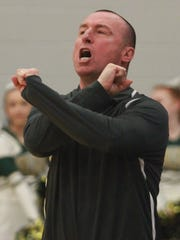 Gallatin Coach Bobby Luna shouts out and gestures a play as his team takes on Beech on Fri. Dec. 8, 2017.  Photo by Dave Cardaciotto