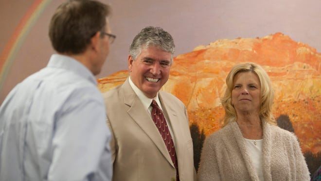 David Clark, Zions Bank senior vice president of international banking, meets with friends and colleagues in celebration of his upcoming retirement Friday, Jan. 8, 2015.