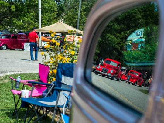 Reflections of old cars are seen in the window of a 1936 Chevy at the 43rd Annual Frog Follies at the Vanderburgh County 4-H Center on Saturday, August 26, 2017.