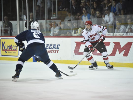 Defenseman Ben Finkelstein, a South Burlington native, looks to skate past an opponent with the puck while playing for the St. Lawrence men's hockey team.
