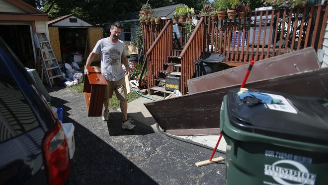 Rodney Schertzer of Norwood, who has lived in his house for the last three years, said he is taking the opportunity to not only clean up his house following flooding this week, but also to throw out old stuff.