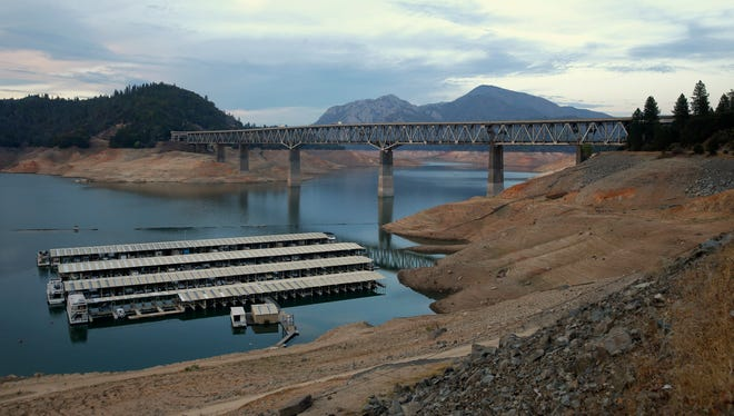 In this photo taken Sept. 17, 2014, house boats are docked at Lake Shasta's Bay Bridge resort near Redding, Calif.  After three years of drought the water level at the lake has dramatically receded.