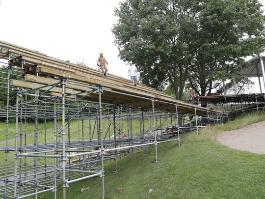 Workers were busy assembling the grandstands Tuesday for the upcoming LPGA tournament at Thornberry Creek at Oneida golf course.