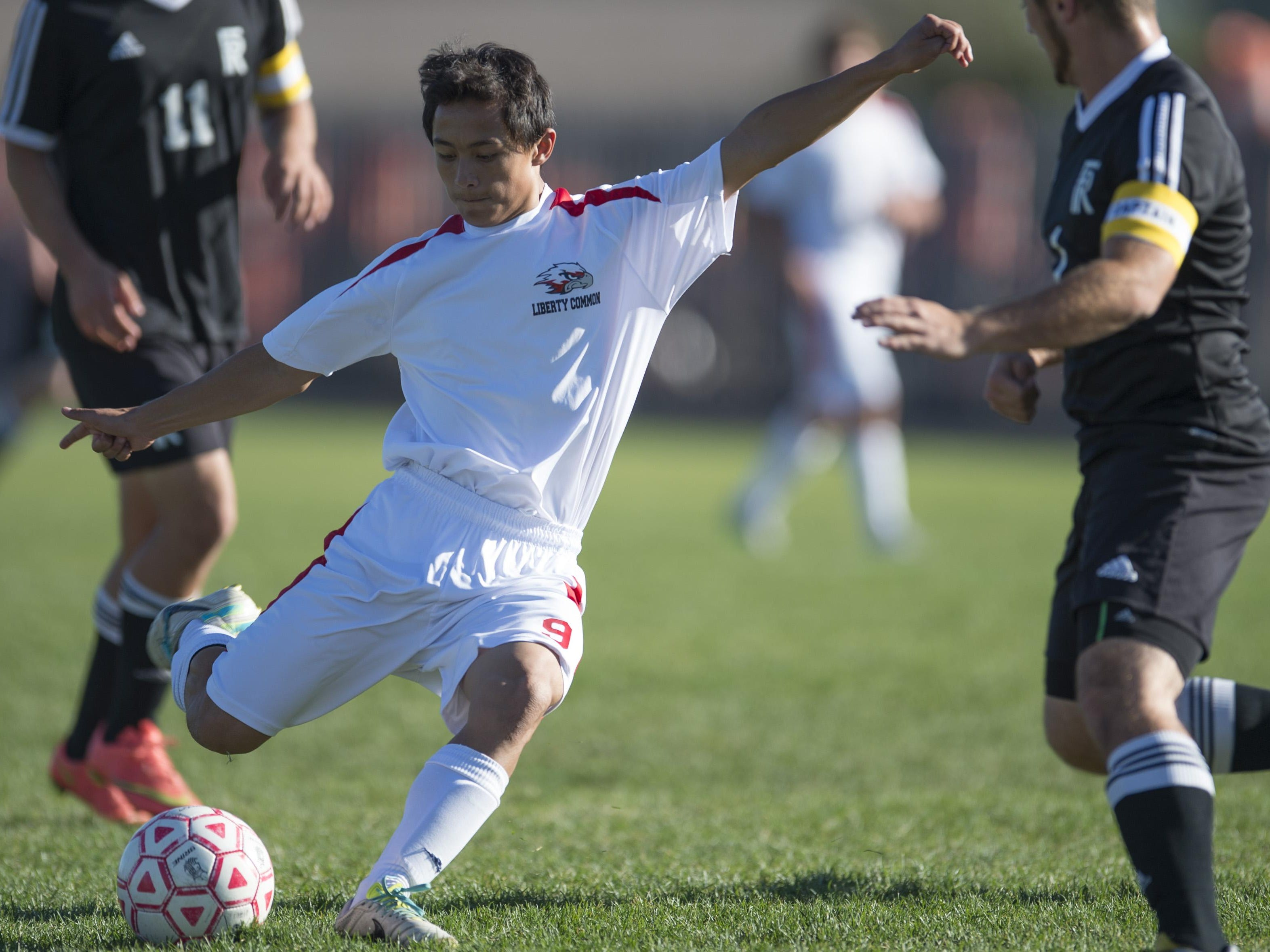 Michael Yeh of Liberty Common sends the ball down the field during a game against Front Range Christian Tuesday, October 13, 2015.