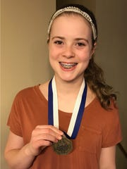 Hannah Winkels won a gold medal in the Everest Area Optimist Club's oratorical contest.