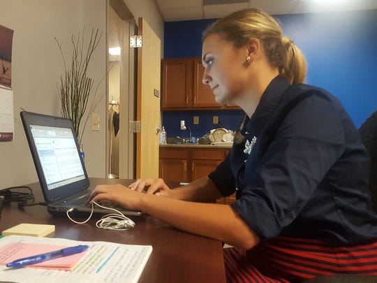 At her desk, Myrannda Kleckner, of Cleona, goes through her email in the Harrisburg office of the Chesapeake Bay Foundation. Kleckner, a student at Pennsylvania State University, is serving an internship at the CBF.
