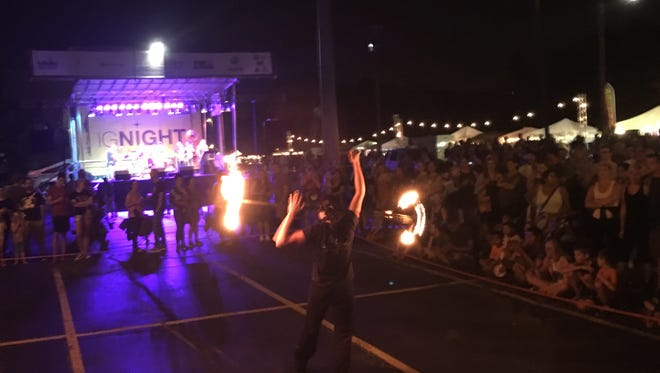 A fire performer lights up the third igNight Market of 2017. The trio of night arts events earned On Broadway Inc. a Wisconsin Main Street Award for Best Special Event.