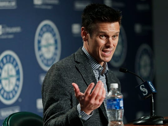 FILE - In this Jan. 25, 2018, file photo, Seattle Mariners general manager Jerry Dipoto speaks during the Mariners annual media briefing before the start of spring training baseball. As general manager Jerry Dipoto accurately explained, the Seattle Mariners are a team stuck in the middle. They're not in the position of rebuilding. They have enough talent and enough veterans _ with big contracts _ to be competitive. But they're not among the elite of the American League, including the Houston Astros in their own division.(AP Photo/Ted S. Warren, File)
