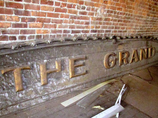 The original sign for the movie theater that once stood