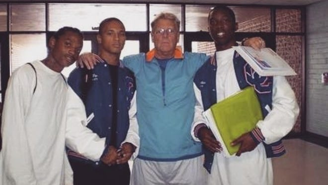 From left to right: Prince Holloway, Spencer Boyd, Cape Coral High football coach Mike Goebbel, Jaylen Watkins