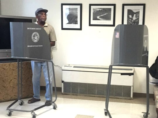 City of Poughkeepsie voter Lester Savage, 83, casts