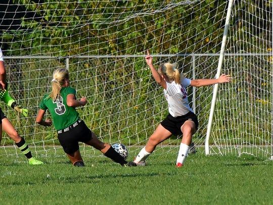 Ally Schultz (3) of Bishop Brossart kicks home a goal