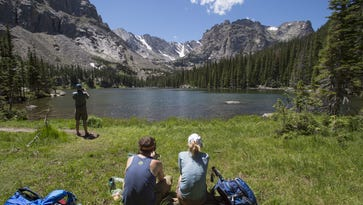 Hikers visit Loch Vale in Rocky Mountain National Park on Saturday, July 23, 2016. The park set another attendance record in 2016 with more than 4.5 million visitors.