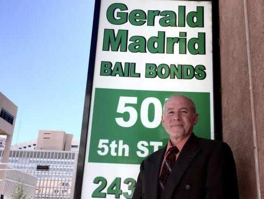 Bail bondsman Gerald Madrid, standing outside his Albuquerque