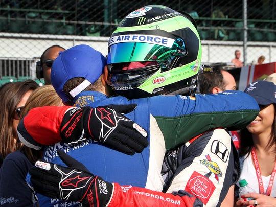 An emotional Dale Coyne Racing IndyCar driver Conor Daly (17) is hugged by former teammate Carlos Munoz (29) as the two made the field of 33 cars on qualification day for the Indianapolis 500 at the Indianapolis Motor Speedway on Saturday, May 19, 2018.